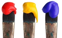 three paint tipped brushes
